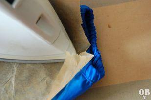Mit Backpapier und auf niedrigster Stufe aufbügeln